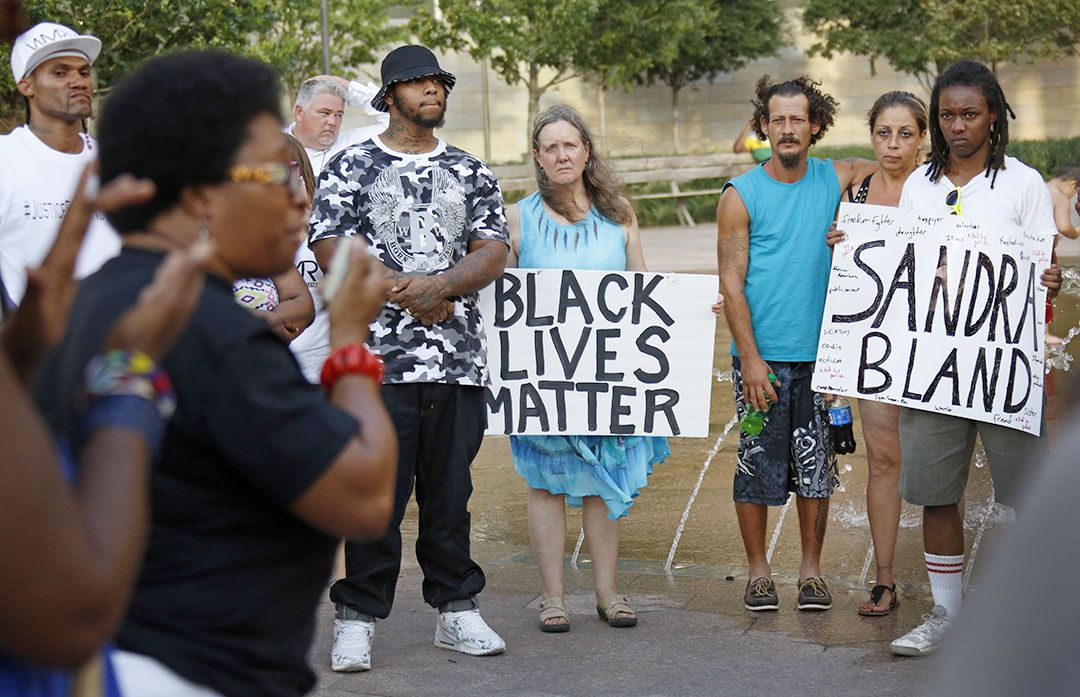 Local activists and community members gather for a prayer vigil and march for Sandy Bland, who died in police custody, at Belo Garden Park in downtown Dallas on Saturday, July 18, 2015. (Louis DeLuca/The Dallas Morning News)