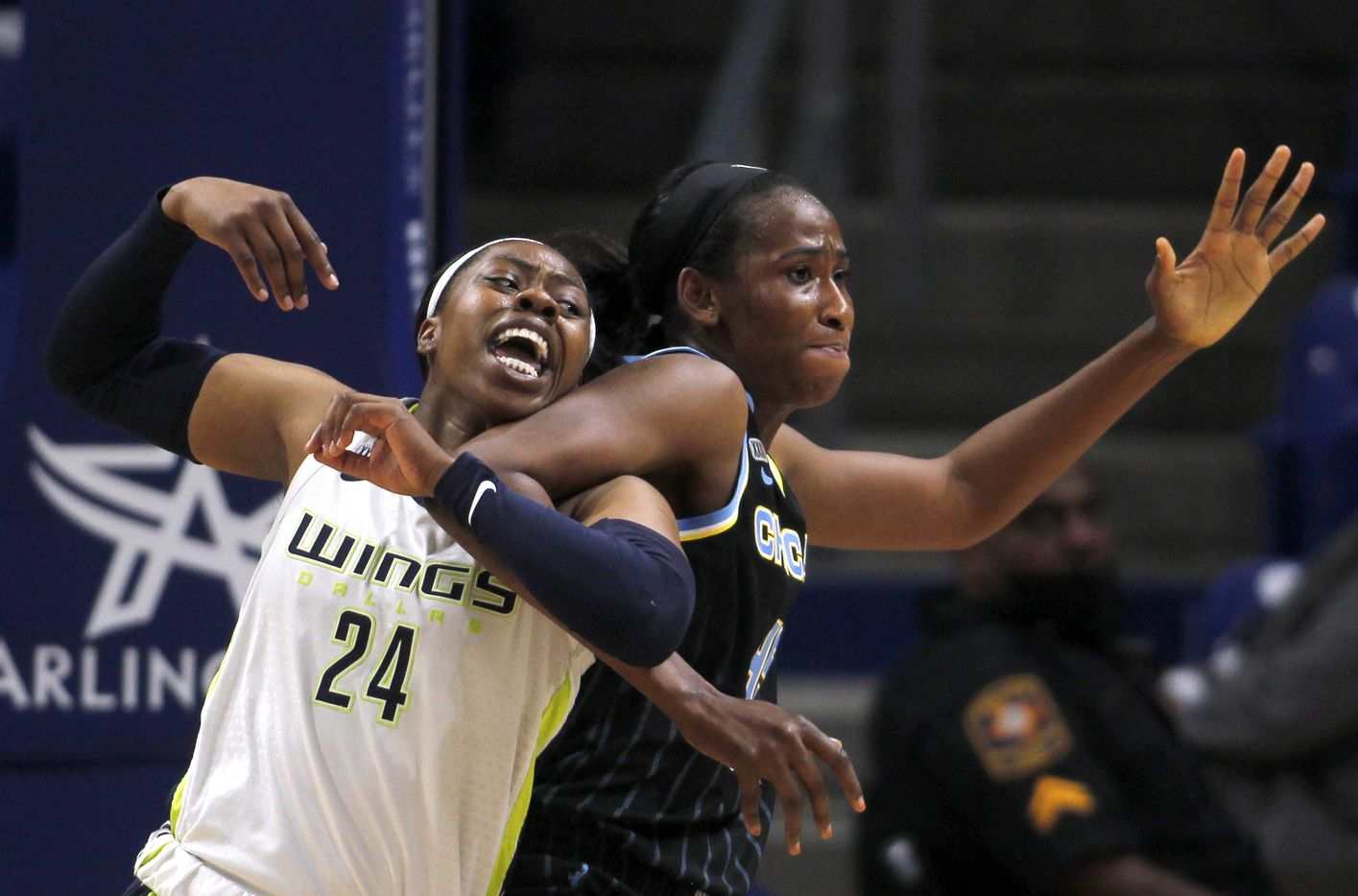 Dallas Wings guard Arike Ogunbowale (24) becomes tangled with Chicago Sky center Astou Ndour-Fall (45) as the two battled for rebound positioning during 2nd half action. Dallas won 100-91.The two WNBA teams played their game at College Park Center in Arlington on July 2, 2021. (Steve Hamm/ Special Contributor)
