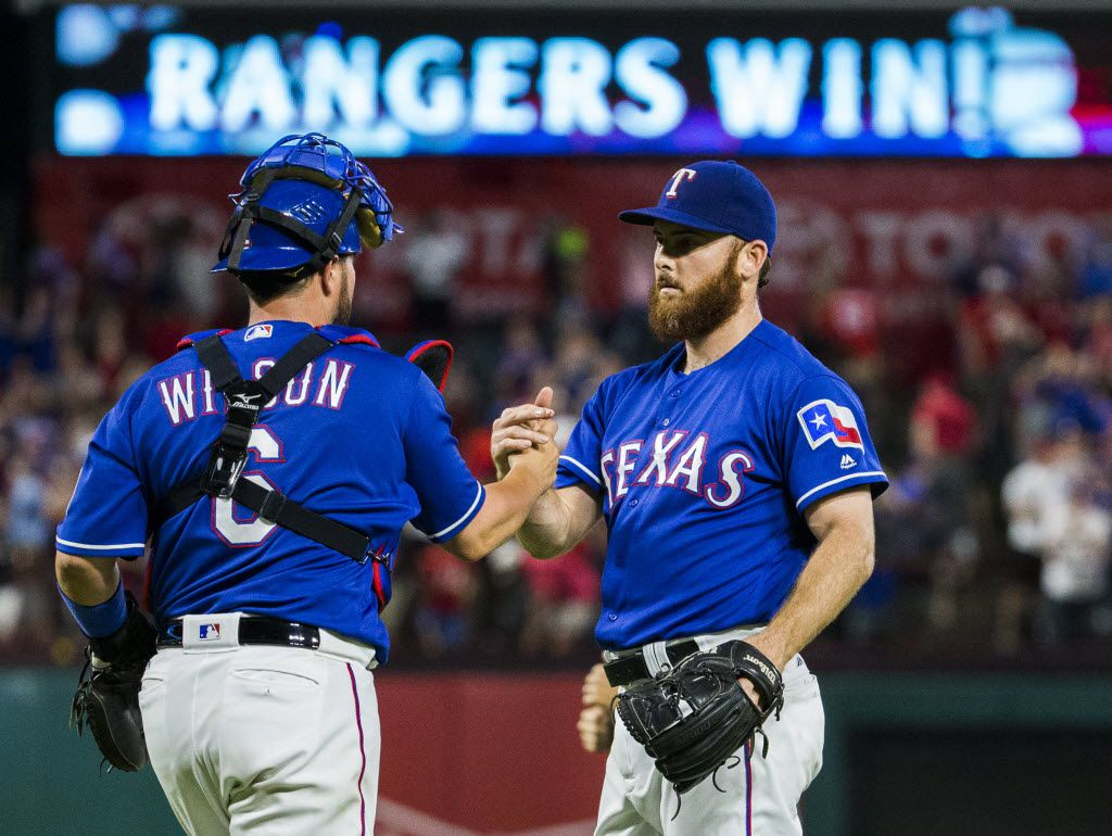 Texas Rangers catcher Bobby Wilson (6) high-fives relief pitcher Sam Dyson (47) after a 4-3 win over the Houston Astros on Tuesday, June 7, 2016 at Globe Life Park in Arlington, Texas.  (Ashley Landis/The Dallas Morning News)