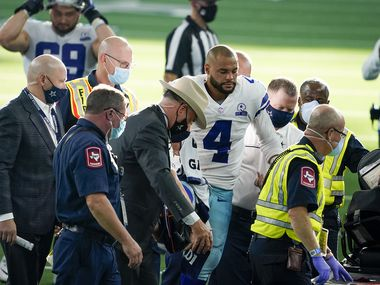 Cowboys quarterback Dak Prescott leaves the field on a cart after being injured on a tackle by Giants defensive back Logan Ryan during the third quarter of a game at AT&T Stadium on Sunday, Oct. 11, 2020, in Arlington.