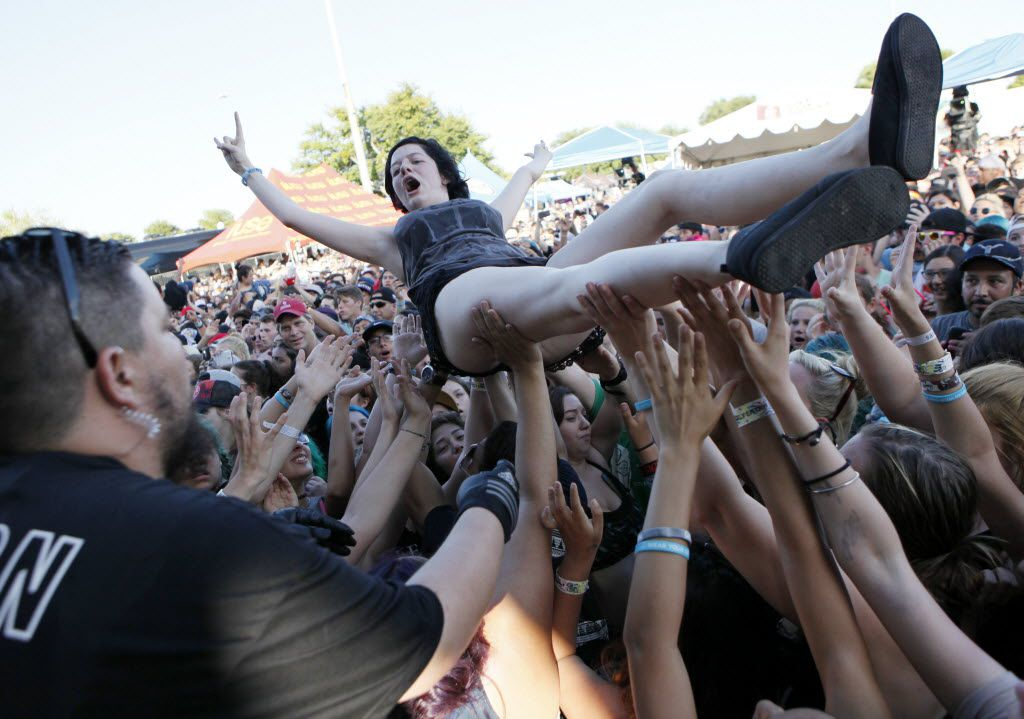 A young woman crowd surfs before being safely put to her feet by stage personnel during the performance by the band Sleeping with Sirens at the Vans Warped Tour, on Friday, June 24, 2016 at Gexa Energy Pavilion in Dallas. (Ben Torres/Special Contributor)