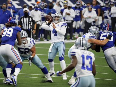 FILE - Cowboys quarterback Dak Prescott (4) throws a pass toward the end zone during the first quarter of a game against the Giants at AT&T Stadium Stadium in Arlington on Sunday, Oct. 11, 2020.