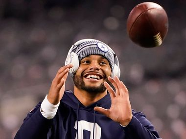 Dallas Cowboys quarterback Dak Prescott warms up before an NFL football game against the Chicago Bears at Soldier Field on Thursday, Dec. 5, 2019, in Chicago. (Smiley N. Pool/The Dallas Morning News)