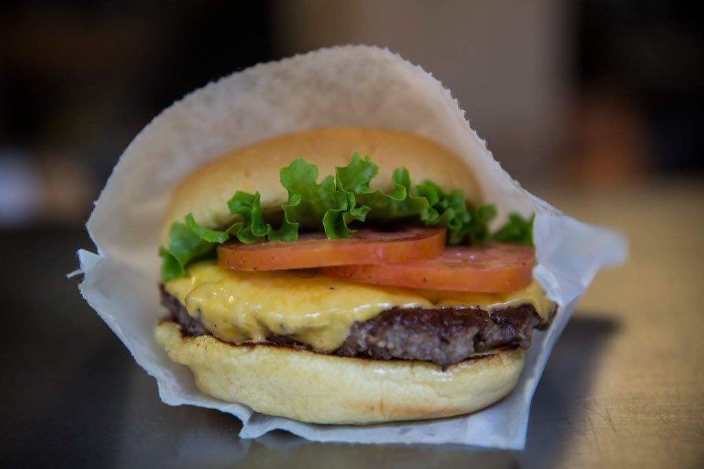 A Shake Shack burger. NEW YORK, NY - AUGUST 18: A Shake Shack burger is displayed on August 18, 2014 in Madison Square Park in New York City. Shake Shack is allegedly considering going public and holding an initial price offering (IPO).  (Photo by Andrew Burton/Getty Images) ORG XMIT: 507811691,503816393