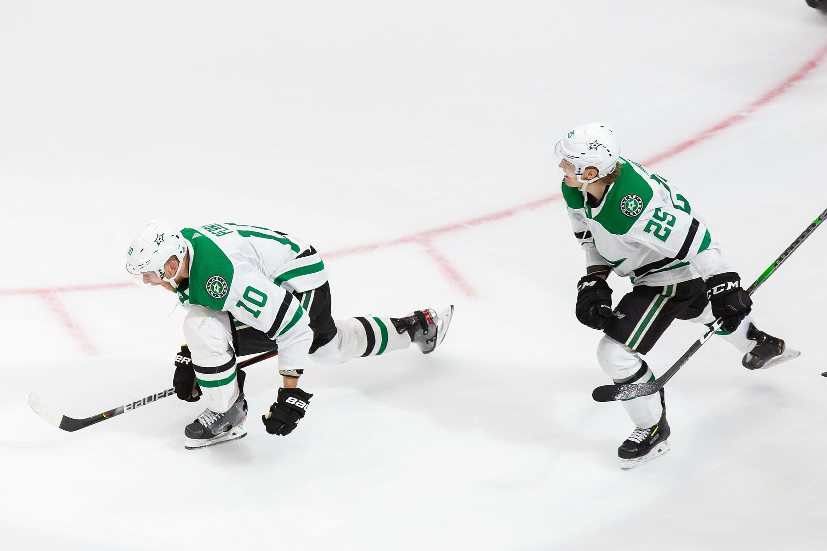 Corey Perry (10) and Joel Kiviranta (25) of the Stars celebrate Perry's game-winning goal against the Lightning during Game 5 of the Stanley Cup Final at Rogers Place in Edmonton, Alberta, on Saturday, Sept. 26, 2020.