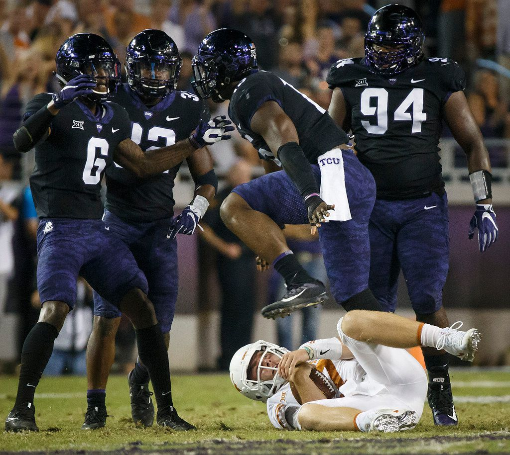 TCU defensive end Ben Banogu (15) celebrates with safety Innis Gaines (6), linebacker Travin Howard (32) and defensive lineman Corey Bethley (94) after sacking Texas quarterback Shane Buechele (7) during the first half of an NCAA football game at Amon G. Carter Stadium on Saturday, Nov. 4, 2017, in Fort Worth, Texas. (Smiley N. Pool/The Dallas Morning News)