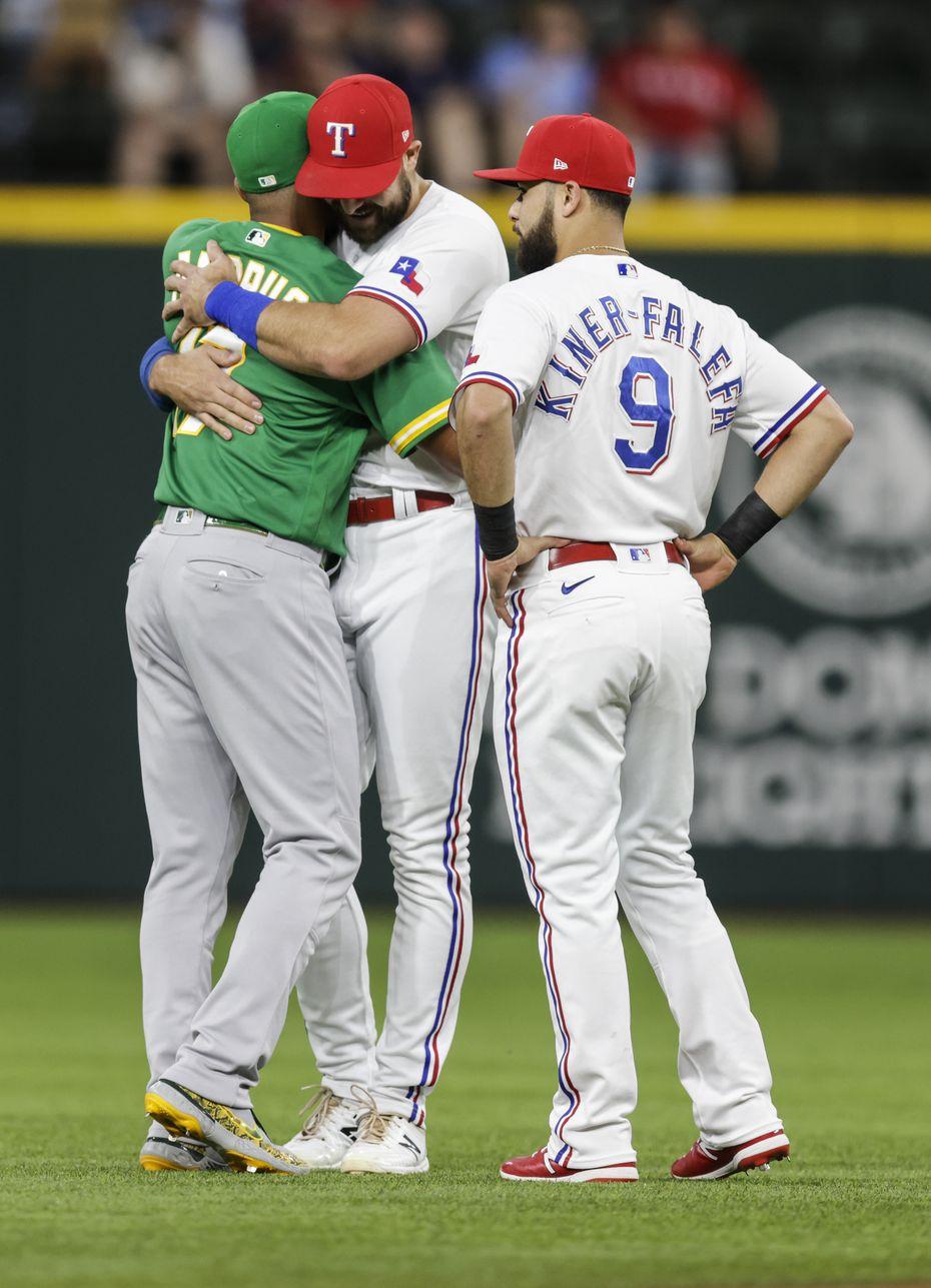 Oakland Athletics shortstop Elvis Andrus, left, greets former teammates Texas Rangers' Joey Gallo and Isiah Kiner-Falefa (9) before a baseball game in Arlington, Monday, June 21, 2021.