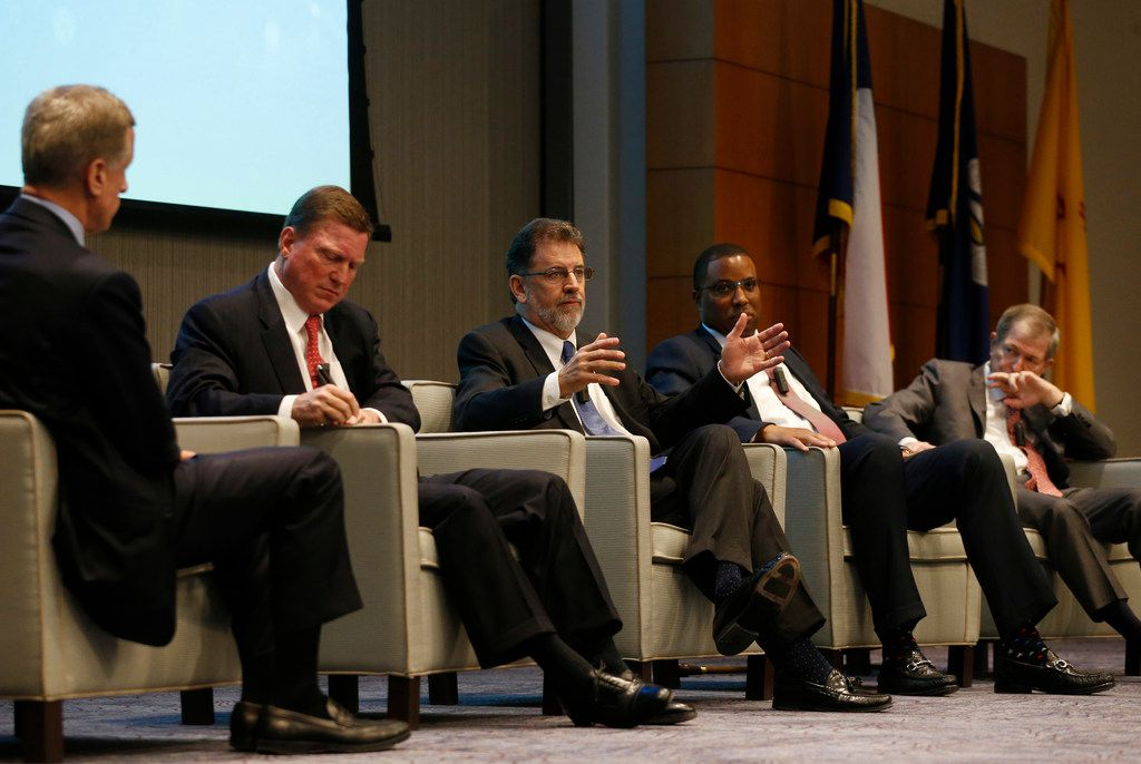 """John Stephens, AT&T chief financial officer (center) speaks as Robert S. Kaplan, president and CEO of Federal Reserve Bank of Dallas (far left) Tom Fanning, chairman, president and CEO of Southern Company (second from left), Troy Taylor, chairman and CEO at Coke Florida (second from right) and Myron E. """"Mike"""" Ullman, former CEO and chairman of the board at J.C. Penney (right) listen during a panel titled, """"The Disruption Challenge Facing Business,"""" at the Federal Reserve Bank of Dallas on Thursday, May 24, 2018."""