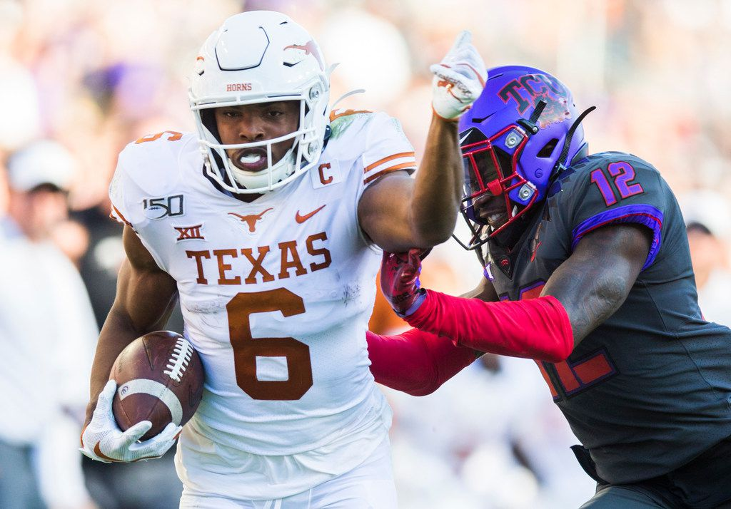 Texas Longhorns wide receiver Devin Duvernay (6) is pushed out of bounds by TCU Horned Frogs cornerback Jeff Gladney (12) during the third quarter of an NCAA football game between the University of Texas and TCU on Saturday, October 26, 2019 at Amon G Carter Stadium in Fort Worth. (Ashley Landis/The Dallas Morning News)