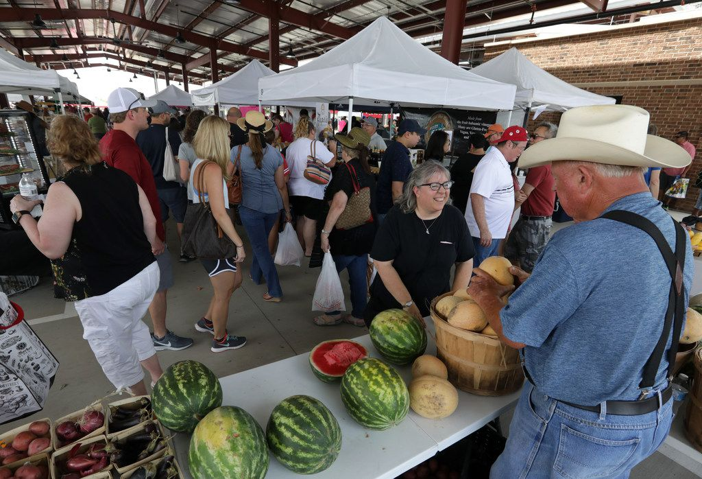 Guests check out the fresh produce, artisan crafts, and food during the Frisco Fresh Market in Frisco.