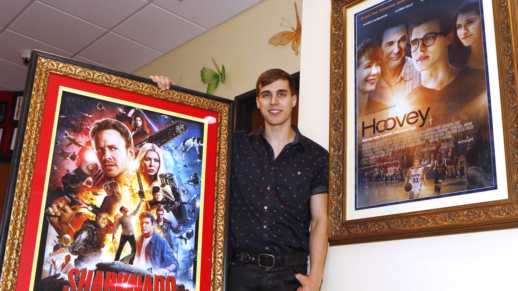 Cody Linley poses between two movie posters that he was part of at Cathryn Sullivan''s Acting For Film Studio in Lewisville where he gave acting classes this week.