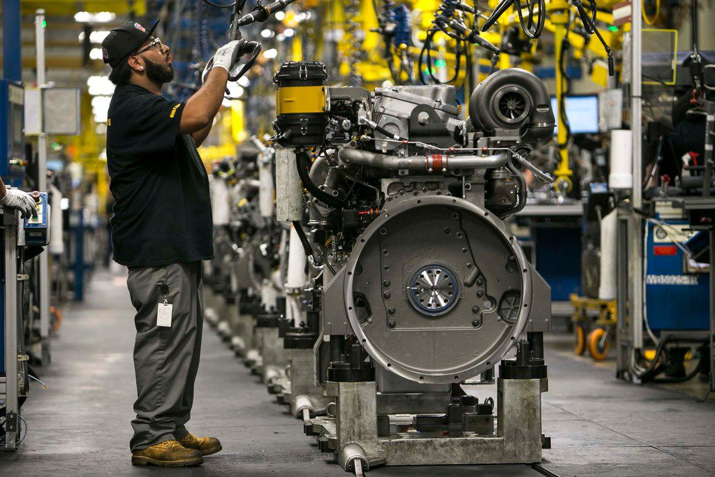 Mike Gomez assembles an engine at Caterpillar's engine manufacturing plant in Seguin. Exports are a major driver of the Texas economy and President Trump announced a preliminary trade deal with Mexico, the state's top trading partner.