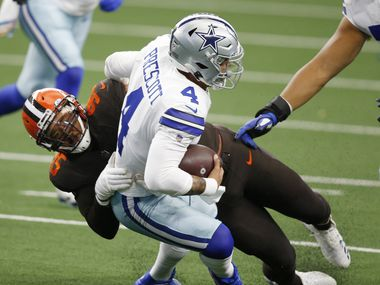 Cleveland Browns defensive end Myles Garrett (95) sacks Dallas Cowboys quarterback Dak Prescott (4) during the first quarter of play at AT&T Stadium in Arlington, Texas on Saturday, October 4, 2020.