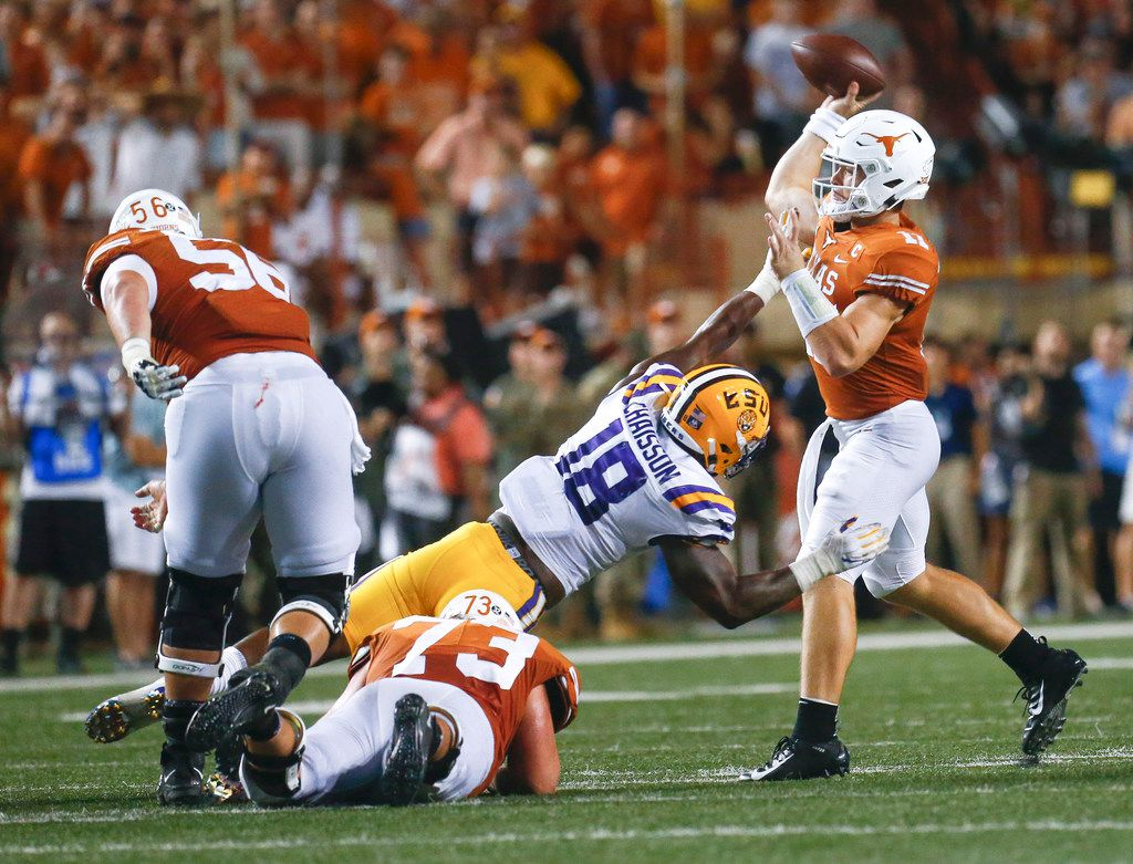 Texas Longhorns quarterback Sam Ehlinger (11) fires off a pass over an attempted block by LSU Tigers linebacker K'Lavon Chaisson (18) during the third quarter of a college football game between the University of Texas and Louisiana State University on Saturday, Sept. 7, 2019 at Darrell Royal Memorial Stadium in Austin, Texas. (Ryan Michalesko/The Dallas Morning News)