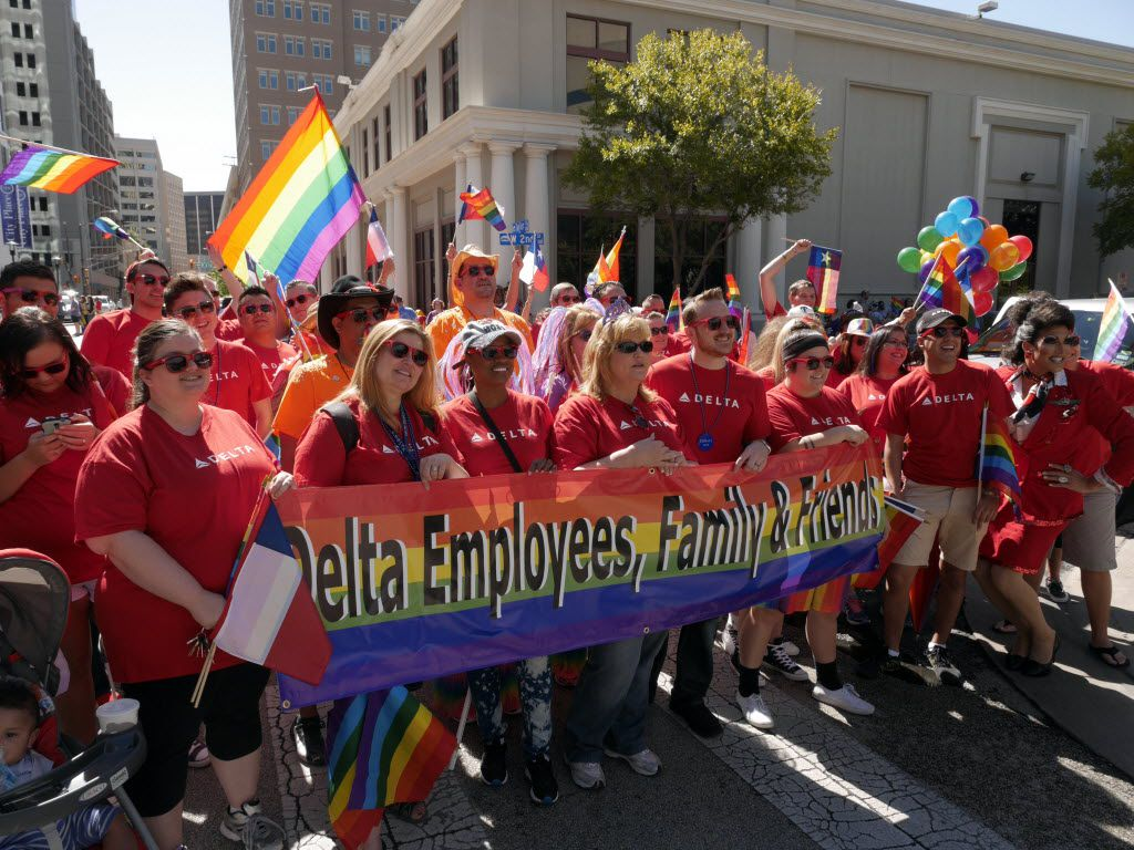 Delta Airlines employees, family and friends pose for a group photo at the 2014 Pride Parade and Pride Street Festival in downtown Fort Worth on Oct. 4, 2014.