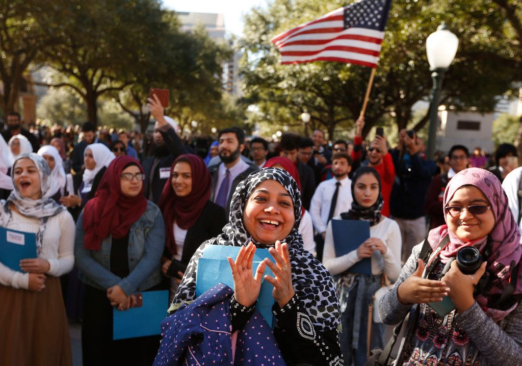 Naheda Khan and daughter Meherina Khan, 18 of Houston clap as they cheer for America during a press conference at the steps of the Texas Capitol during the Texas Muslim Capitol Day rally in Austin on Tuesday, January 31, 2017.