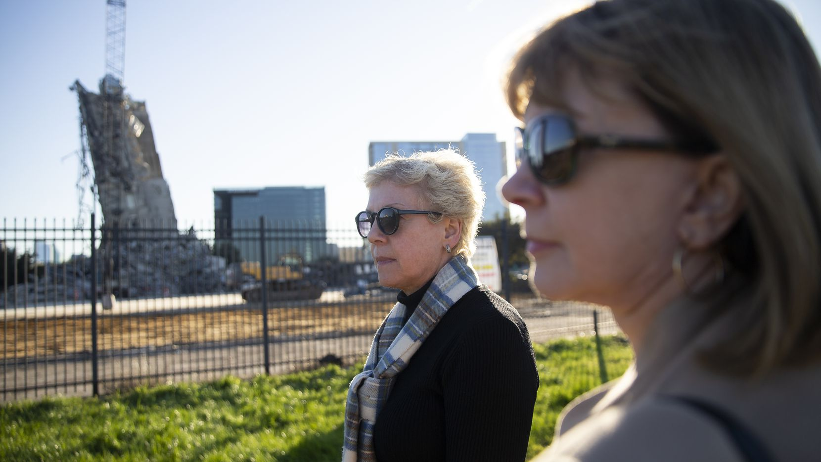 Ann Spillman (left) and Jane Spillman Wansley, daughters of the late Pat Y. Spillman of Fisher and Spillman, the architect group that designed the building that the Leaning Tower of Dallas used to be, stop to see the tower on Feb. 27, 2020 in Dallas. (Juan Figueroa/ The Dallas Morning News)