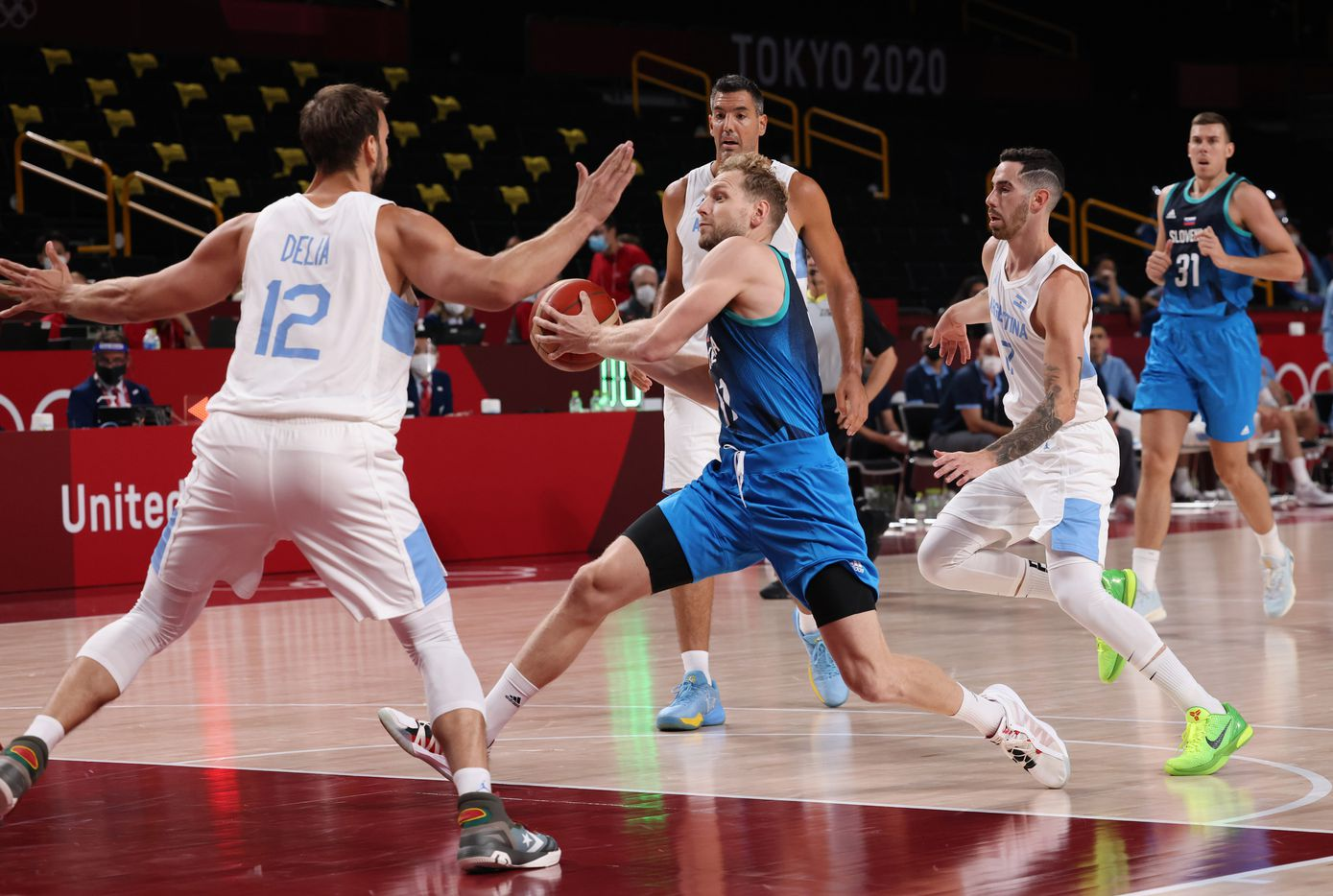 Slovenia's Jaka Blazic (11) drives on Argentina's Marcos Delia (12) in the first half of play during the postponed 2020 Tokyo Olympics at Saitama Super Arena on Monday, July 26, 2021, in Saitama, Japan. Slovenia defeated Argentina 118-100. (Vernon Bryant/The Dallas Morning News)