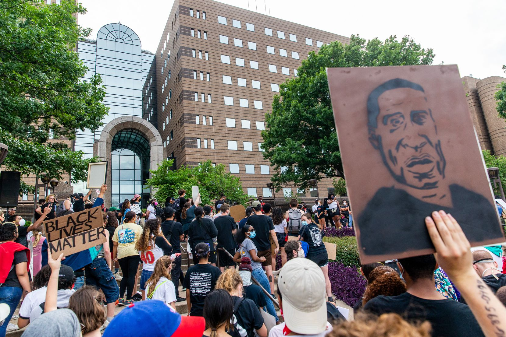 Protesters gather outside the Frank Crowley Courts building past the city's 7 p.m. curfew during a demonstration denouncing police brutality on Monday, June 1, 2020. The demonstration was organized in response to the recent deaths of George Floyd in Minneapolis and Breonna Taylor in Louisville.