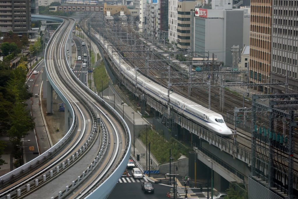 A Shinkansen bullet train heads for Tokyo Station on the Tokaido Main Line. The Shinkansen bullet train began service in 1964 and become a symbol of Japan's technological prowess.