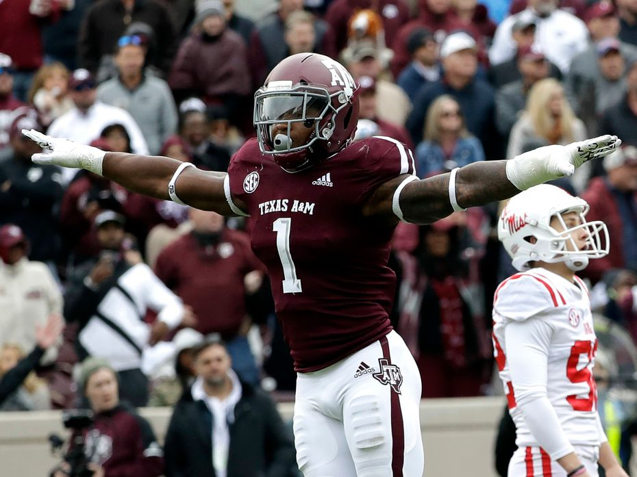 FILE - Texas A&M linebacker Buddy Johnson (1) celebrates after Mississippi kicker Luke Logan, right, missed a field goal during the fourth quarter of a game Saturday, Nov. 10, 2018, in College Station.