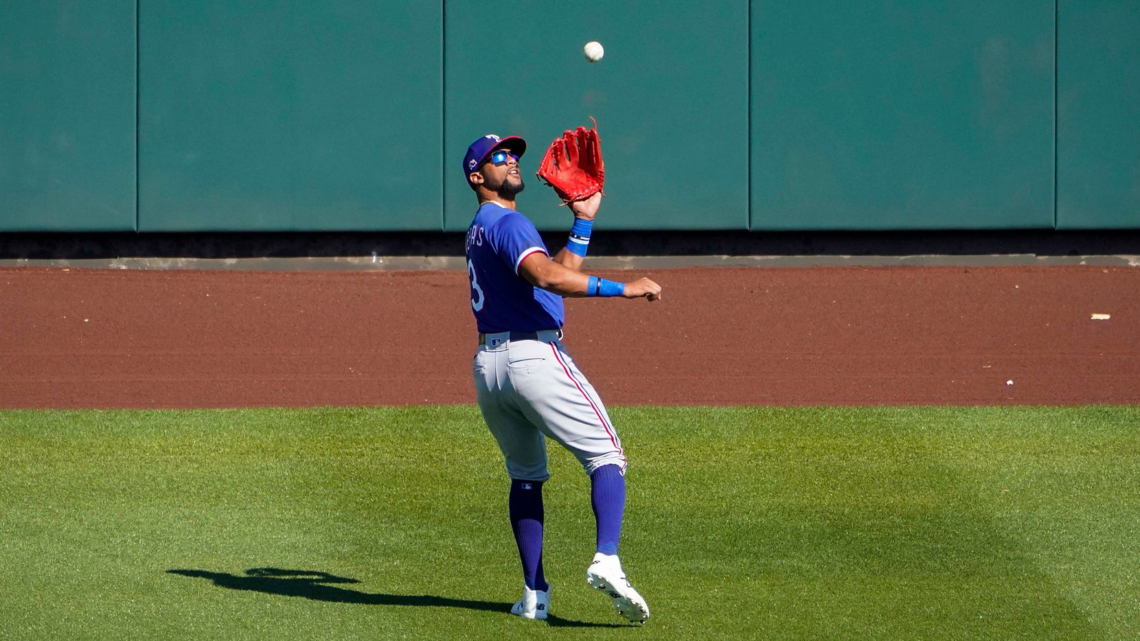 Texas Rangers center fielder Leody Taveras makes a catch on a fly ball by Arizona Diamondbacks first baseman Pavin Smith during the fifth inning of a spring training game at Salt River Fields at Talking Stick on Saturday, March 6, 2021, in Scottsdale, Ariz.