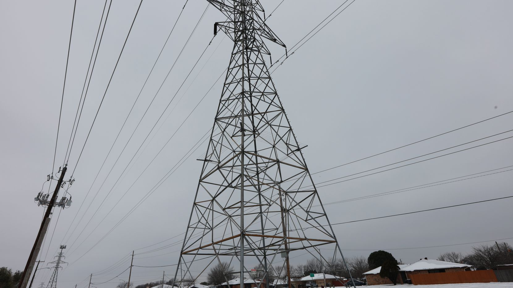 A power transmission tower in Fort Worth after a snow storm on Feb. 17, 2021.