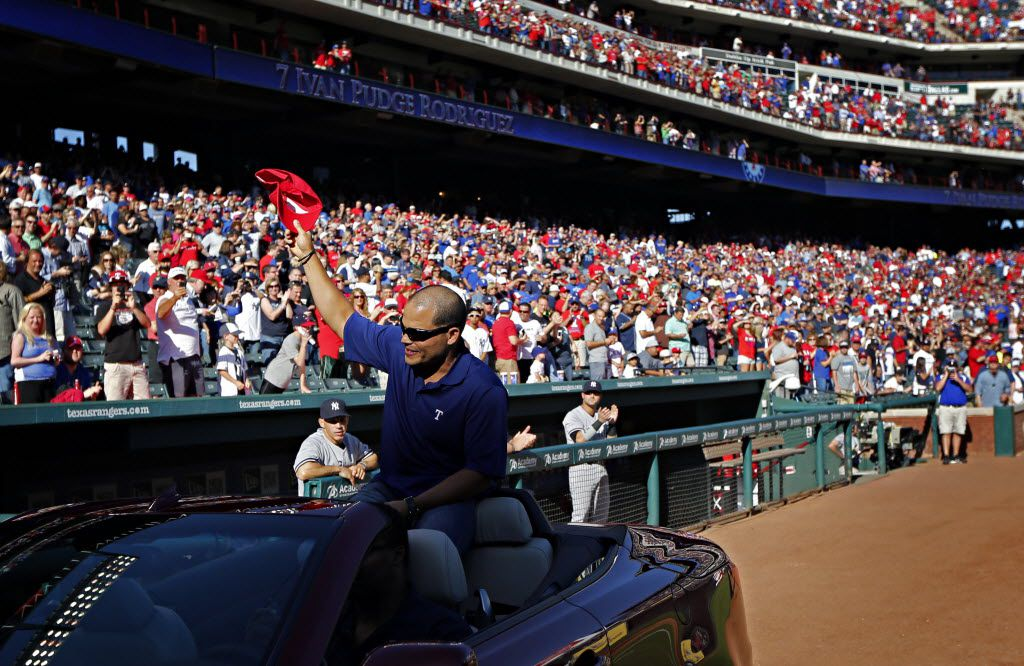 FILE - Former Texas Rangers catcher Ivan Rodriguez waves to the crowd during his retirement ceremony before a game between Texas and the New York Yankees on Monday, April 23, 2012 in Arlington. (G.J. McCarthy/The Dallas Morning News)