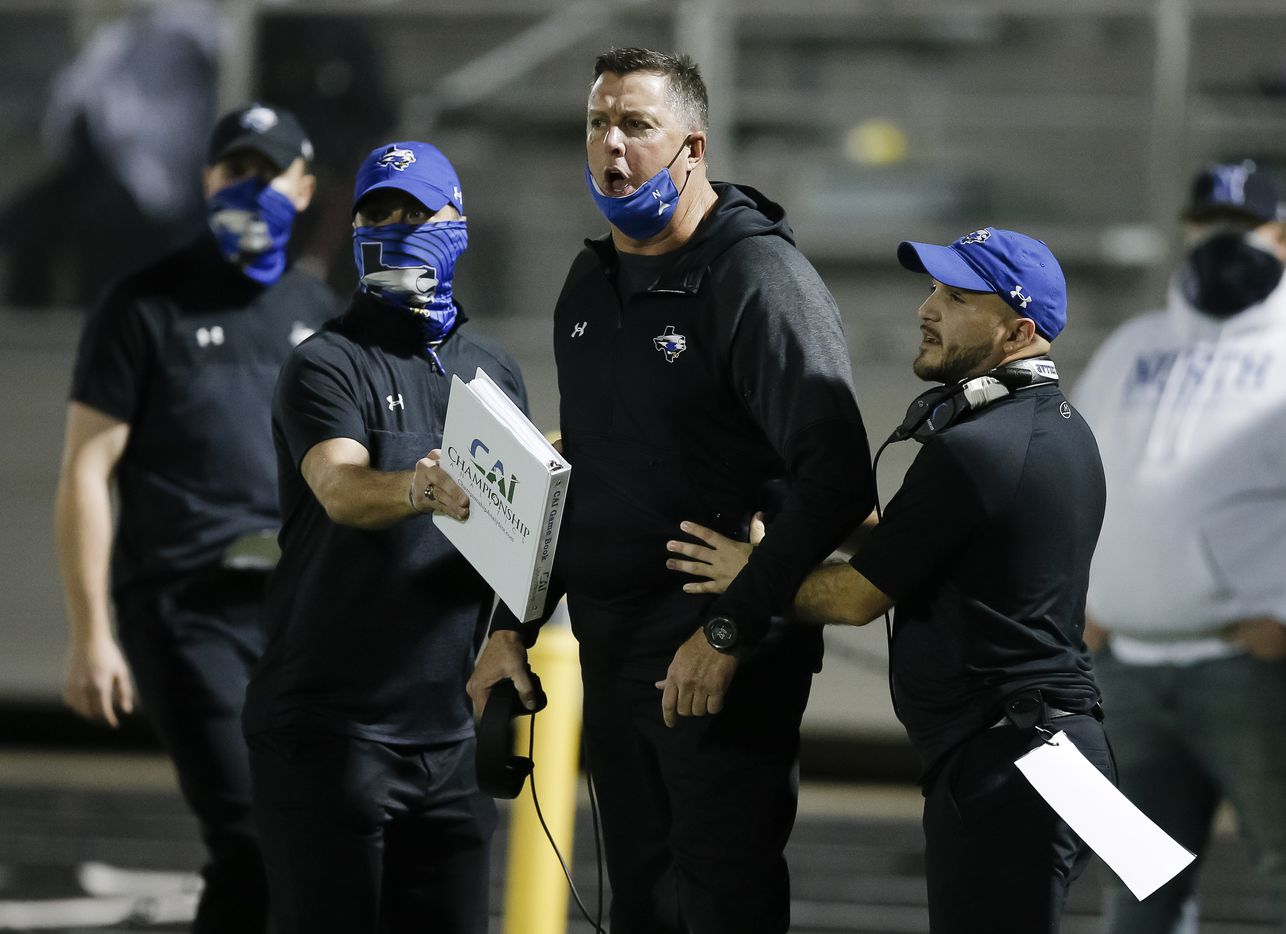 North Forney head coach Randy Jackson, center, is held back by assistant coaches while arguing a call with an official during the second half of a high school playoff football game against Ennis in Forney, Thursday, November 19, 2020. Ennis won 38-14. (Brandon Wade/Special Contributor)