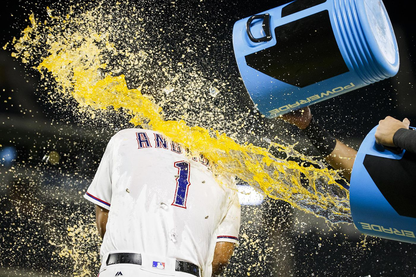 Texas Rangers shortstop Elvis Andrus is doused with sports drink after a victory over the Tampa Bay Rays at Globe Life Park on Tuesday, May 30, 2017, in Arlington.