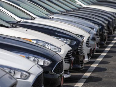 Rows of used cars sit on a lot in North Texas.