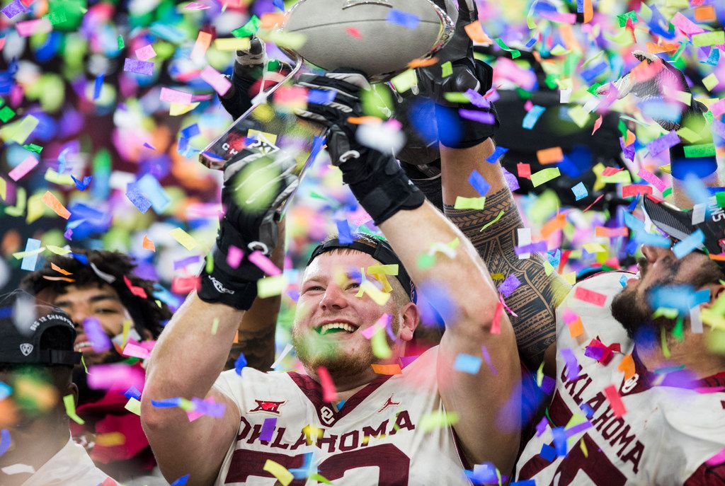 Oklahoma Sooners offensive lineman Ben Powers (72) holds up of the Big 12 Championship trophy after the Sooners won 39-27 over the Texas Longhorns on Saturday, December 1, 2018 at AT&T Stadium in Arlington, Texas.