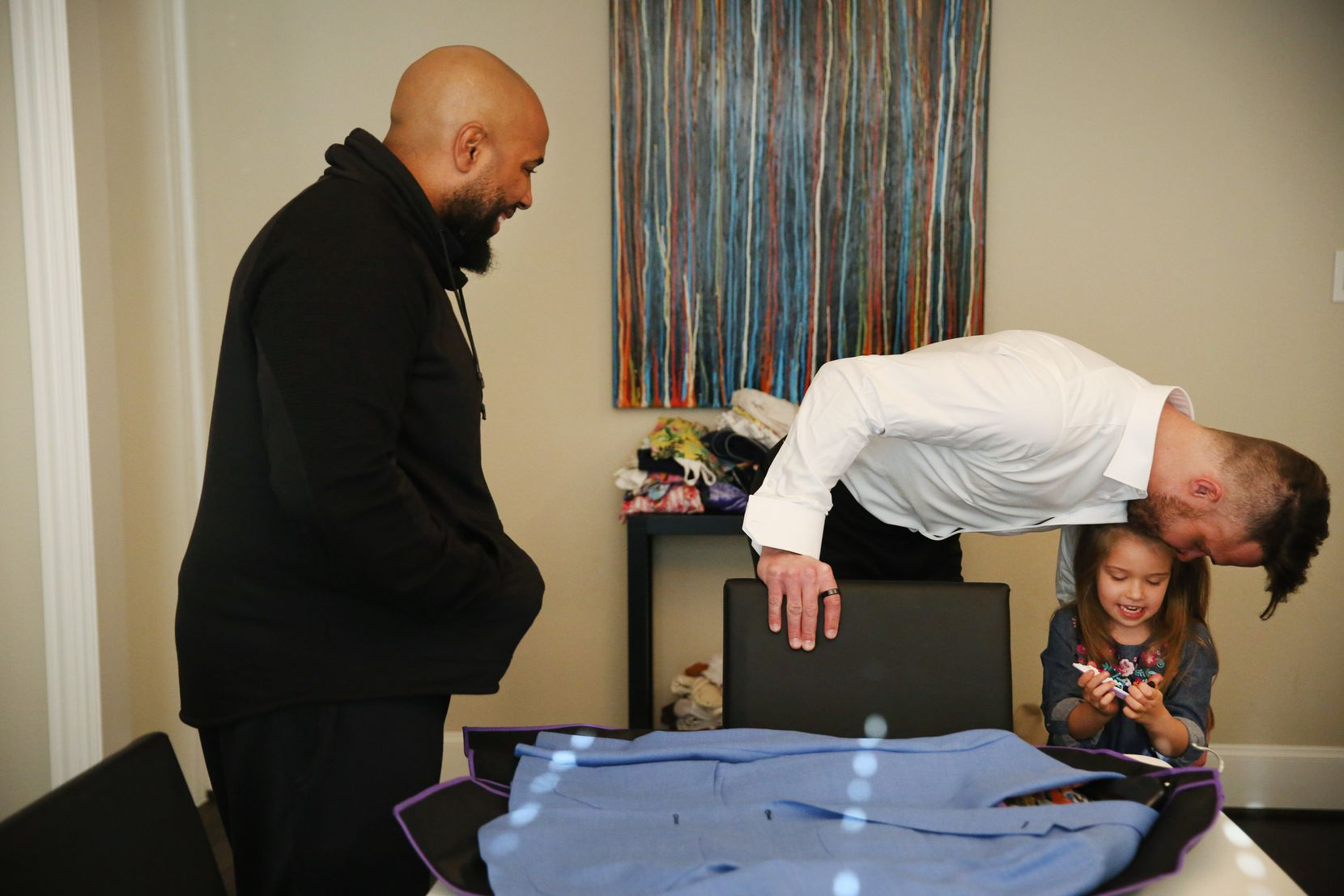 David Vobora kisses his daughter Elealeh as he tries on tuxes at home in The Colony.