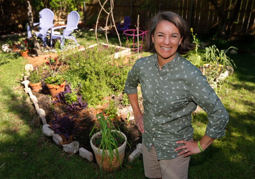 Shelley Cramm in her garden at her home in Irving.