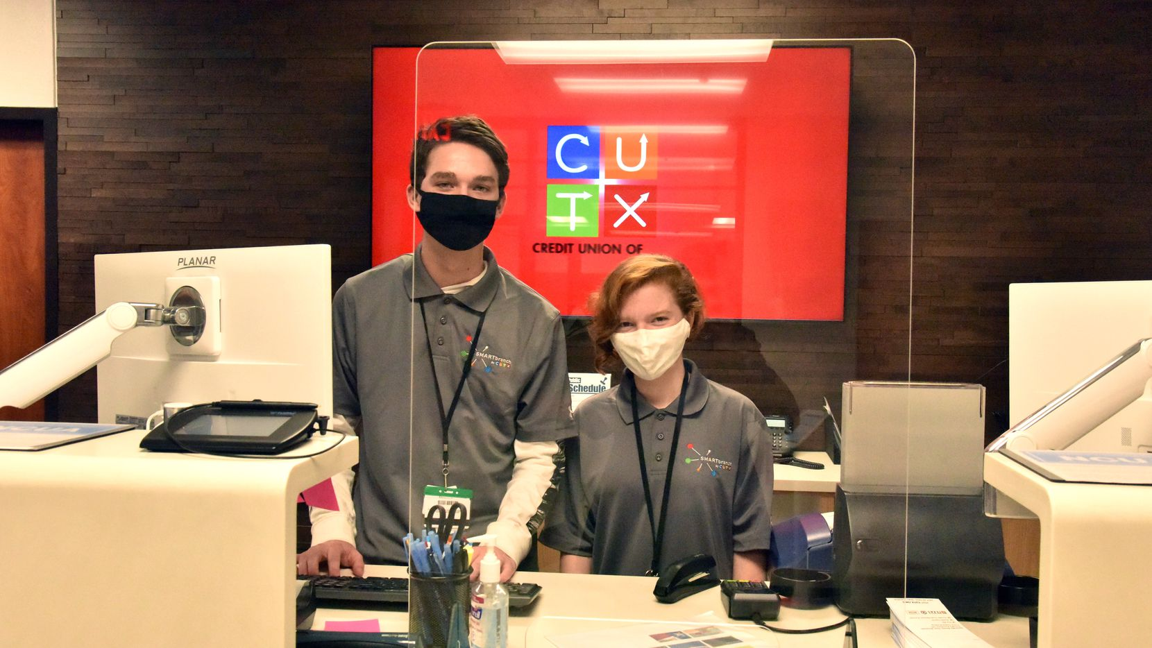 Alex Motion and Sydney Byers, juniors at Allen High School, pose at the Credit Union of Texas SMART Branch in the school.