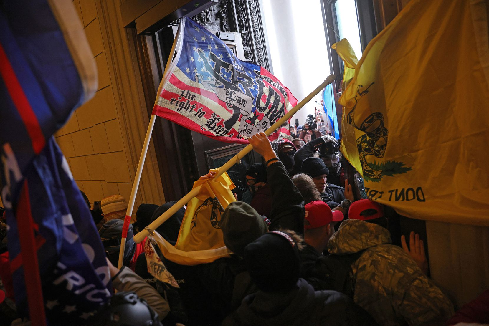 Protesters supporting U.S. President Donald Trump break into the U.S. Capitol on Wednesday, Jan. 6, 2021 in Washington, D.C. Congress held a joint session today to ratify President-elect Joe Biden's 306-232 Electoral College win over President Donald Trump. A group of Republican senators said they would reject the Electoral College votes of several states unless Congress appointed a commission to audit the election results. (Win McNamee/Getty Images/TNS)