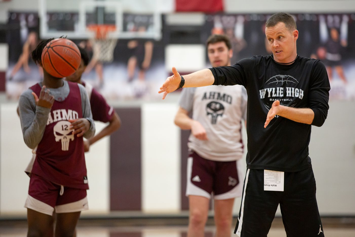 Wylie High School head basketball coach Stephen Pearce directs players in a drill during practice at Wylie High School on March 11, 2020 in Wylie, Texas. (Kara Dry/Special Contributor)