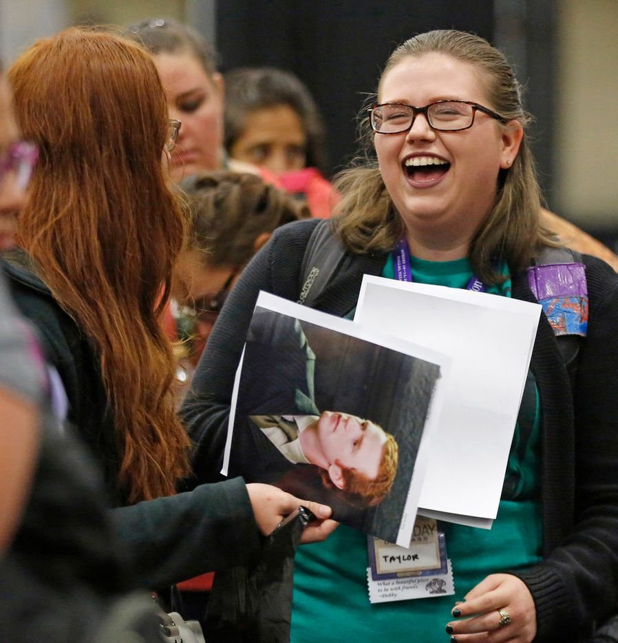 Fans share a laugh as they wait to get an autograph from actor Chris Rankin.