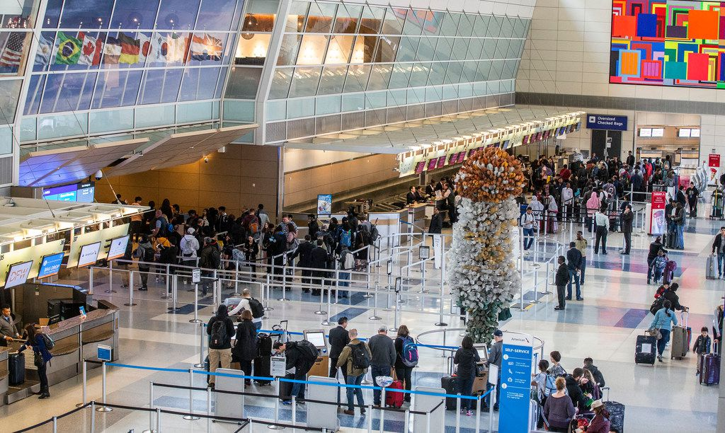 Four days before Christmas in 2019, travelers waited through long security lines at DFW International Airport's Terminal D.