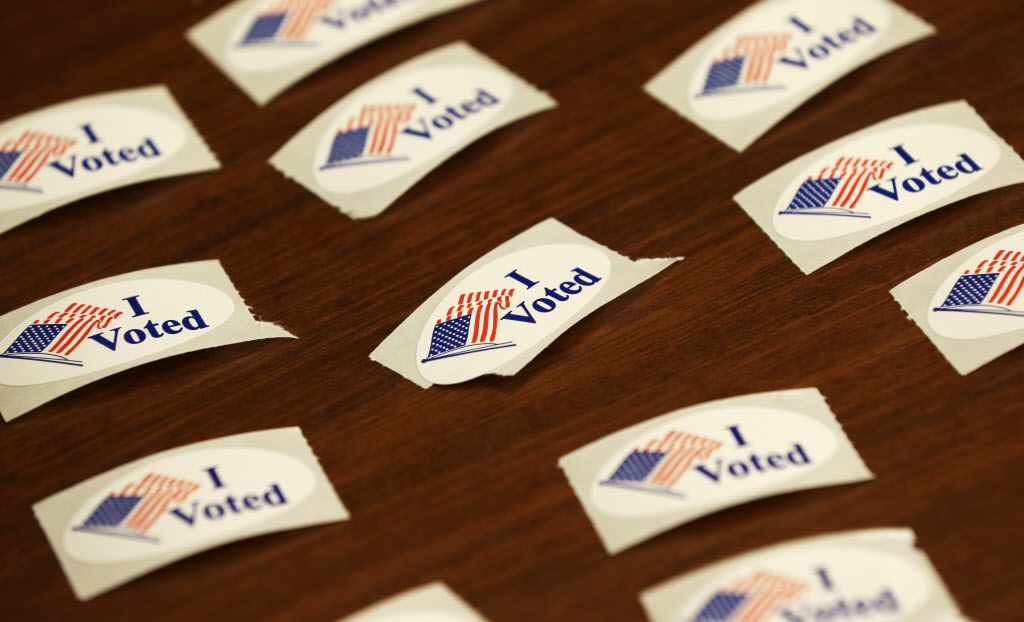 """""""I Voted"""" stickers sit on a table at a 2016 polling location."""