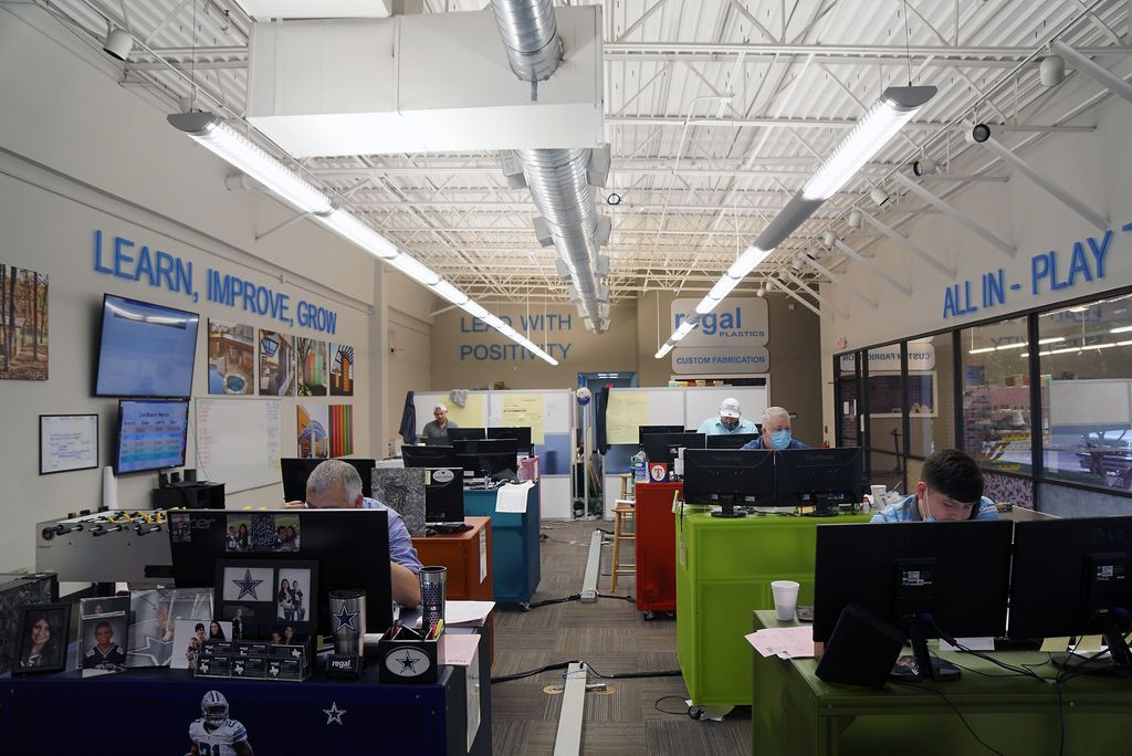 With their core values on the walls above them, sales reps take calls at Regal Plastics.