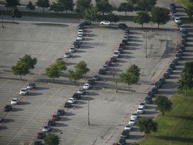 Hundreds of cars weave around the Ellis Davis Field House at a COVID-19 test site on Friday, June 26, 2020 in Dallas. (Ryan Michalesko/The Dallas Morning News)