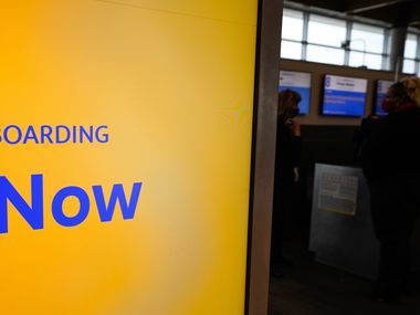 A display shows boarding in progress for a Southwest Airlines flight at Dallas Love Field on Thursday, Jan. 7, 2021, in Dallas. (Smiley N. Pool/The Dallas Morning News)