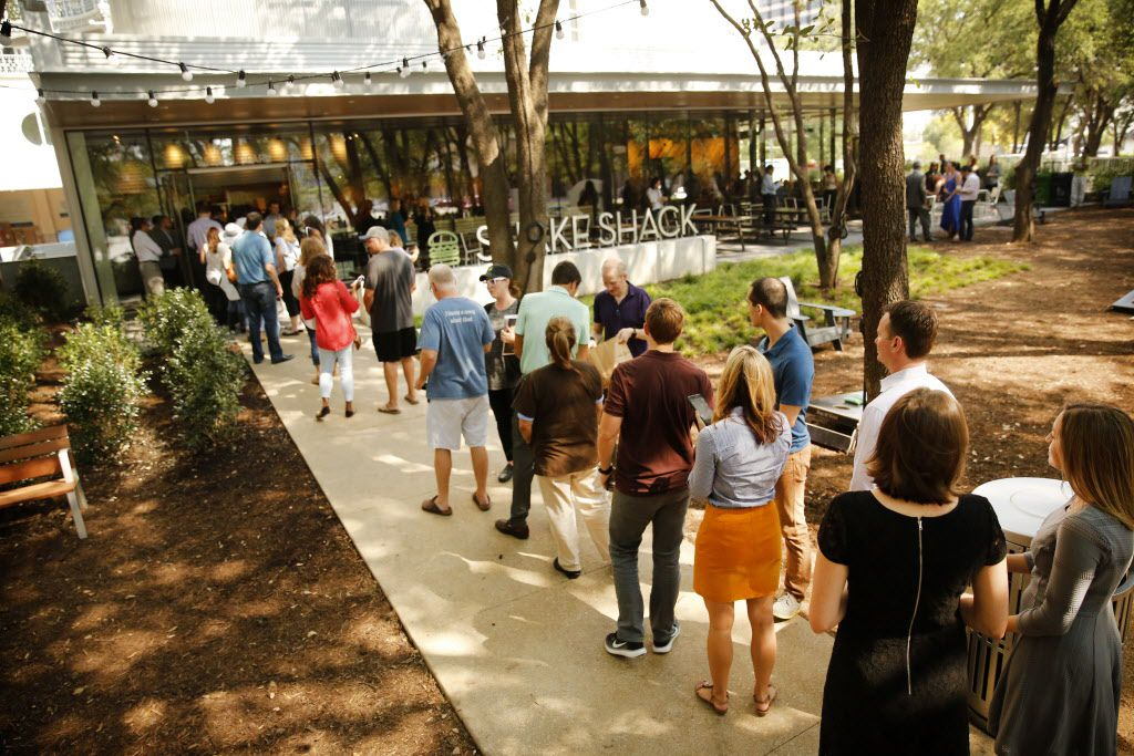 Lunchtime patrons lined up for the opening of Dallas' first Shake Shack on Pearl St. in Uptown Dallas, Texas, Thursday, September 1, 2016. Shake Shack, which started in New York has become an international burger sensation the past decade, is located in front of the Crescent.