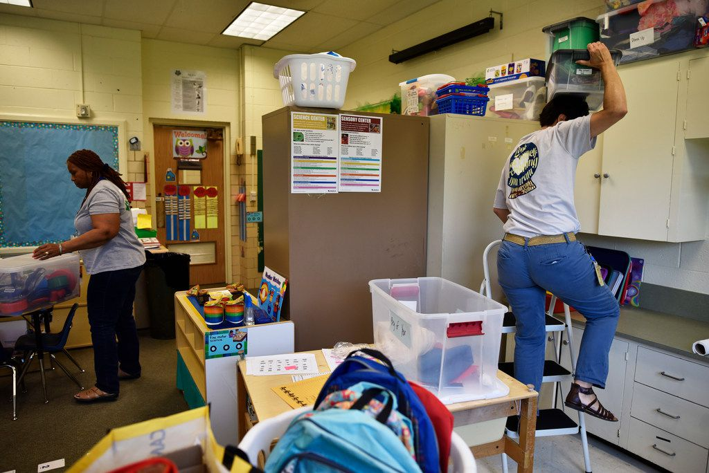 Pre-kindergarten teachers Christeen Clark (left) and Sandy Saucier prepared their shared classroom for the first day of school at Terrance Elementary in Richardson.