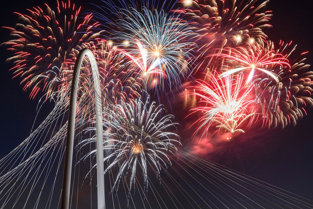 Fireworks explode over the Margaret Hunt Hill Bridge during the Red, White, and Boom on the Bridge event in 2018.