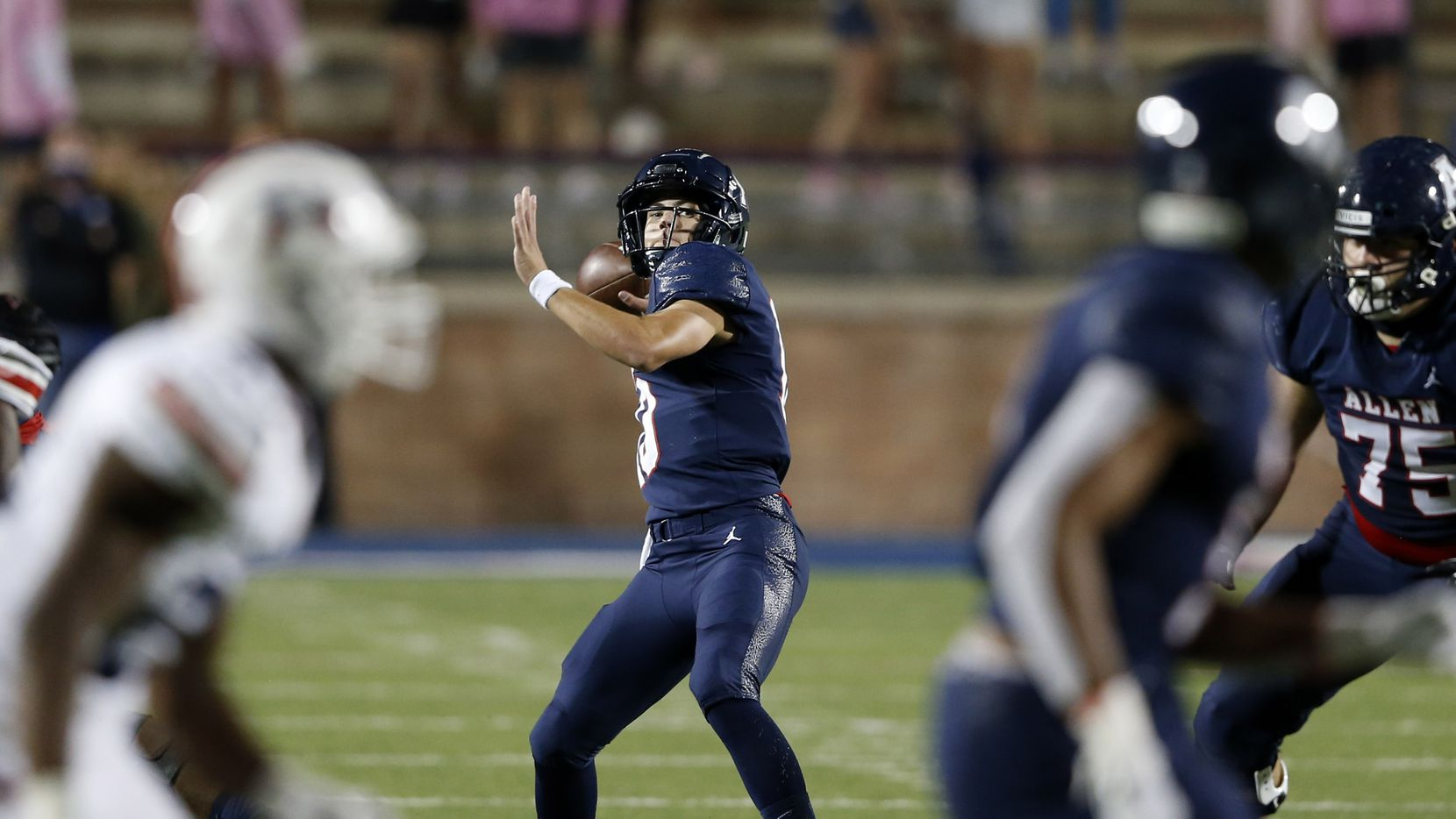 Allen's General Booty (10) gears up to pass the ball to Bryson Green (9) in a game against Humble Atascocita's during the first half of play at Eagle Stadium in Allen, Texas on Friday, October 2, 2020.