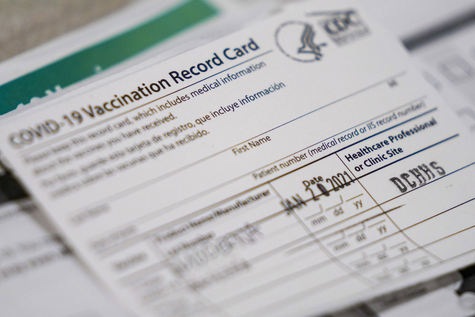 A vaccination record cards sit ready at a station at the Dallas County  COVID-19 mega-vaccination site at Fair Park on Friday, Jan. 22, 2021, in Dallas.