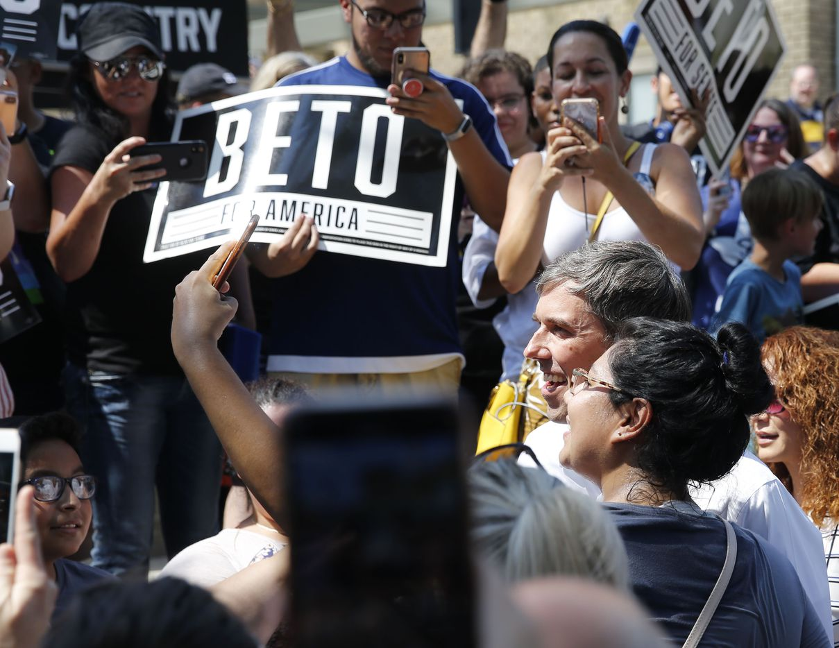 Democratic Presidential candidate Beto O'Rourke takes photos with fans before speaking at a campaign event at Haggard Park in Plano, Texas, on Sunday, September 15, 2019.