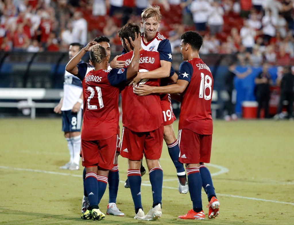 FC Dallas' Michael Barrios (21), Brandon Servania (18) and Paxton Pomykal (19) celebrate with Ryan Hollingshead (12) after his score against the Vancouver Whitecaps during the second half of an MLS soccer match in Frisco, Texas, Wednesday, June 26, 2019. (AP Photo/Tony Gutierrez)